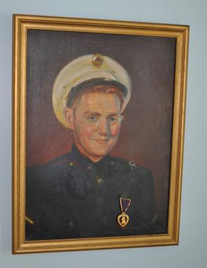 "This portrait of Allen MacQuarrie in Marine regalia, done by a contemporary, Edward Vickers, is a family treasure. Allen's mother affixed his Purple Heart medal to the art work, saying, ""That's where it belongs."""