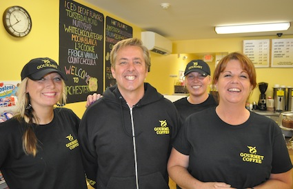 PS Gourmet Coffee: Owner Jim Fallon, second from left, is shown with employees Katelyn Keeley, left, Lauren Karski and Adams Corner store manager Debbie Shaughnessy, far right. Photo by Bill Forry