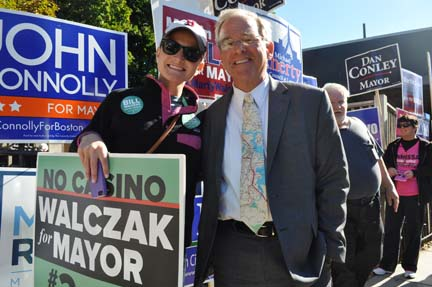 Preliminary election: Bill Walczak, with his daughter Elizabeth, highlighted his opposition to a casino in Boston on his election day signage. The two are shown outside the Cristo Rey School where the candidate voted this morning. Photo by Bill Forry