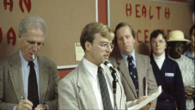 Walczak speaks in 1979. At left, Mayor Kevin White; at right state Rep. W. Paul White. Photo: CSHC.