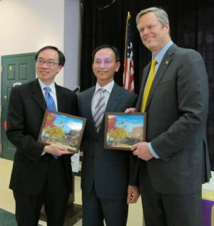 Nam Pham (center) with Gov.-elect Charlie Baker