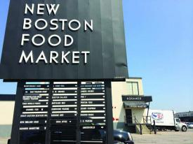 New Boston Food Market: Employs 700 people, many of them local, and could be undermined by a planned trash transfer plant, according to owners.