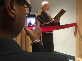 Cardinal Sean O'Malley at the re-dedication of Lower Mills campus: At left, seventh grader Orianeh Byron-Gabelus captured the scene on her phone. Ed Forry photo