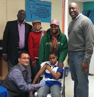 Dorchester YMCA-Carney Hospital Flu Clinic: l-r,  Kevin Washington, CEO YMCA of Greater Boston; Kathy Townsend, Executive Director Dorchester YMCA; Shirley Alexander Hunt; Andy Davis, CEO Carney Hospital; Dr. Miguel Concepcion and Xavier Alexander, receiving his flu shot.
