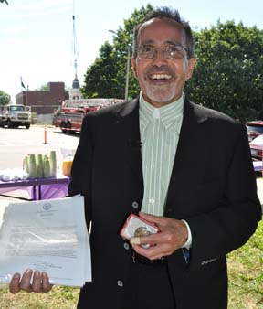 Rev. Art Lavoie: The First Parish minister with items he placed inside a time capsule located near the top of the steeple. Photo by Bill Forry