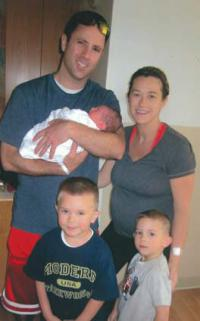 Cellucci Family: In a photo taken before the accident, Kevin Cellucci is shown holding his newborn son Paul, with wife Tina, and boys Stephen, 4, and Declan, 3. Photo courtesy The Kevin Cellucci Foundation