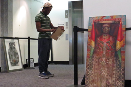 "Black History Art Installation: Rocky Cotard, a Boston Arts Academy senior from Mattapan, curates the art exhibit, ""A Story We Share: Massachusetts Artists Celebrating Black History and Culture, at the Commonwealth Museum and Massachusetts Archives on Columbia Point. The public is invited to the opening celebration on Wednesday evening at 6 p.m.  For further information call 617-727-9268."