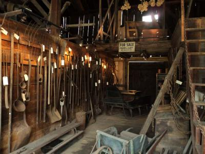 A view inside the refurbished Clapp Family Barn: Tools from Dorchester's agricultural past. Photo by Peggy Mullen