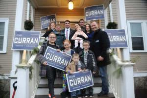 Liam Curran: The candidate, top center, is shown with a group of supporters recently. Curran, 33, is an attorney and former member of the Laborers Local 223. 	                  Photo courtesy Curran campaign