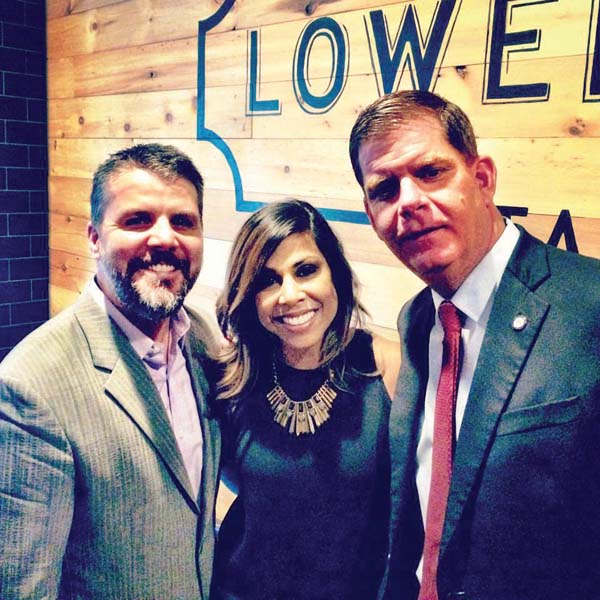 Welcome to the neighborhood: Lower Mills Tavern owner Brian O'Donnell and his wife, designer Taniya Nayak, are shown with Mayor Martin Walsh, who visited the new restaurant for a private event last week. The eatery opens to the public on May 31.  Photo courtesy Lower Mills Tavern