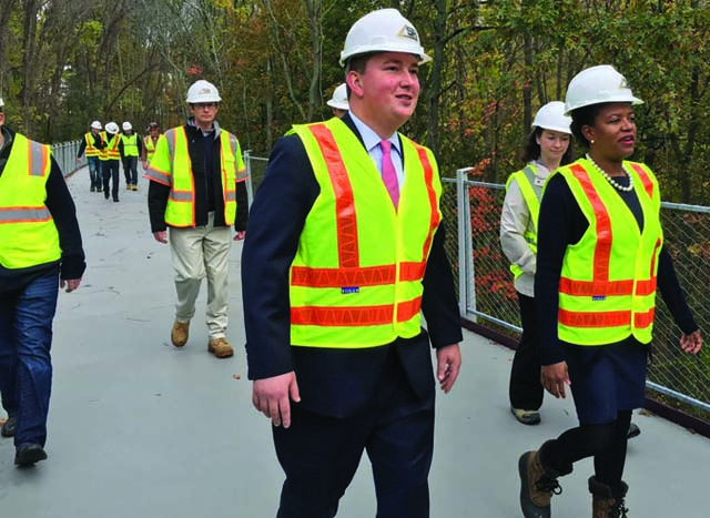 Neponset Greenway Tour: Sen. Forry, right, and Rep. Cullinane walk a new bridge installed this summer over the Neponset River. The span connects Milton and Mattapan.