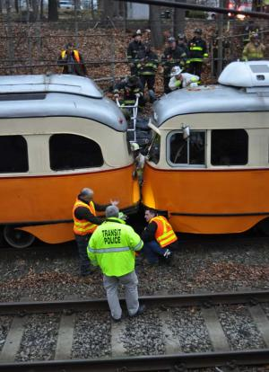 Trolleys collide: Workers inspect the damage. Photo by Bill Forry