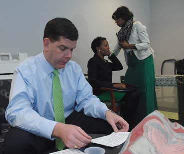 "Mayor Walsh, Sen. Forry prepare for breakfast. : Forry is assisted by cousin Carolyn Brunis in the ""green room"" Photo by Don West"