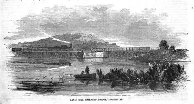 Savin Hill Railroad Bridge circa 1855: An engraving from Ballou's Pictorial Drawing-Room Companion shows a steam engine on a wooden trestle pulling a train across the waters of Dorchester Bay. The MBTA Red Line uses the same route today.