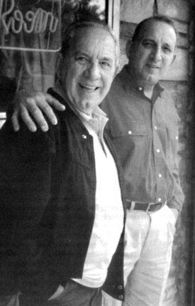 Sonny Elia: The elder restauranteur, left, was shown with his son Richard outside his restaurant in Adams Corner in 1999. Photo by Bill Forry