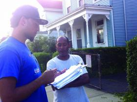Hitting the streets: Cesar Monteiro, 19, spoke with a resident of North Avenue in Roxbury as he collected survey responses this week. 	Photo courtesy CVC UNIDO