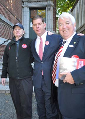Walsh in his home base: The candidate with two key Savin Hill supporters working the polls outside Cristo Rey School. Left, Danny Ryan. Right, Roger Croke. Photo by Bill Forry