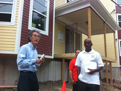 Woodcliff Street Homes: Michael Kozu, left, speaks as homebuilder Vargas DaSilveira and city ISD asst. commissioner Darryl Smith listen outside 6 Woodcliff Street.