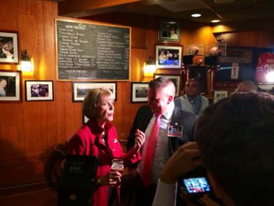 Democratic candidate for governor Attorney General Martha Coakley and Rep. Dan Cullinane chat at the Eire Pub on the eve of the Tuesday Primary. Photo by Lauren Dezenski