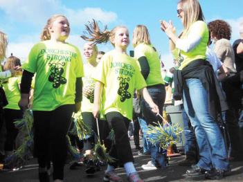 """Dorchester Strong"" — A parade of local Irish dance schools preceded performances at Sunday's Irish Heritage Festival. The indoor and outdoor event drew thousands to Florian Hall and the McKeon Post for a day or music, food and Irish culture. 	Photo by Sean Smith"
