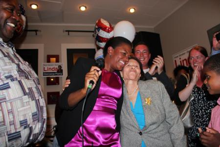 Senator-elect Linda Dorcena Forry: celebrated her election victory on Tuesday night with her mother Annie Dorcena and scores of supporters. Photo by Mike Deehan