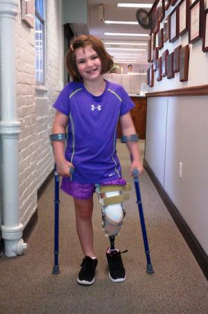 Jane Richard: Dorchester girl, 7, tried out her new prosthetic leg at the United headquarters on Columbia Rd. Photo courtesy Richard family