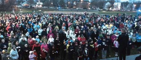 Garvey Park Vigil on April 15, 2014: Fr. Sean Connor, former pastor of St. Ann Church in Neponset, addressed a crowd of some 1,500 people who turned out in the rain at Garvey Park for a vigil to remember Martin Richard and the other victims of last year's bombings at the Boston Marathon. 	Photo by Bill Forry
