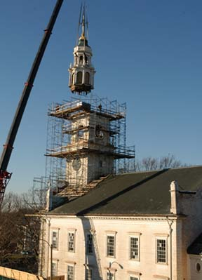 First Parish steeple comes off in 2006: The church has undergone extensive renovations since this photo was taken. On Tuesday, the rebuilt steeple is scheduled to be craned back into place. Photo by Bill Forry