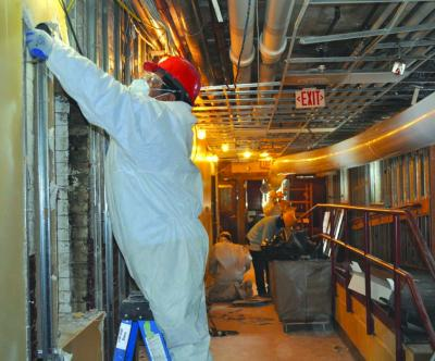 Workers remove damaged walls inside old St. Margaret School building: Photo by Bill Forry