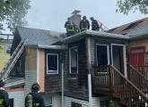 Firefighters at 115 Adams Street fire