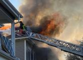 Firefighters at three-alarm fire on Floyd St.