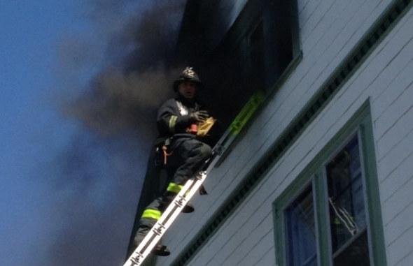 Firefighter at 21 E. Cottage St.