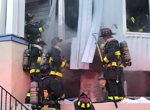 Boston firefighters on Barry Street.