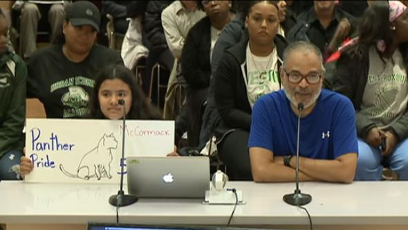 Student shows Panther Pride while addressing the School Committee
