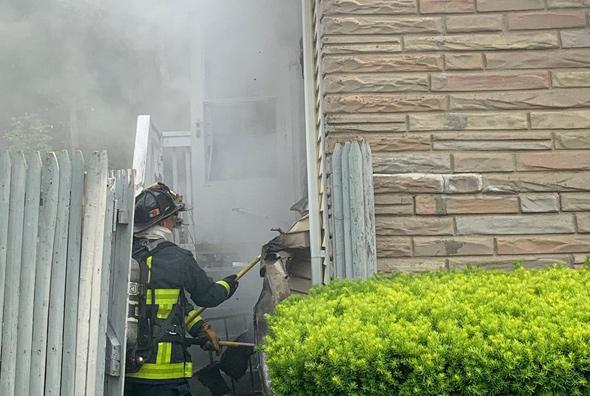 Firefighters enter house on River Street