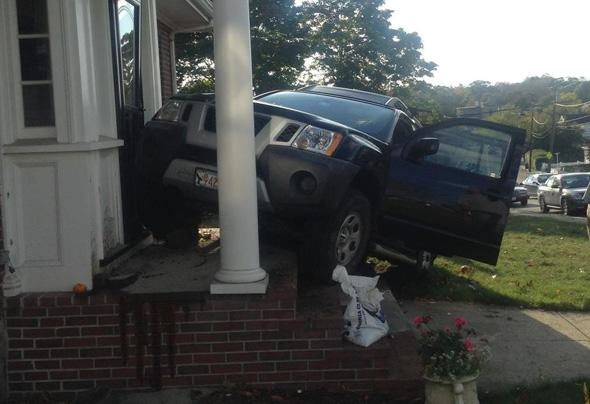 SUV on front porch of 44 Hill Top St.