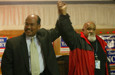 A victorious Charles Yancey: Left, celebrates his election night win with fellow councillor Chuck Turner at the Unity Sports and Cultural Center.
